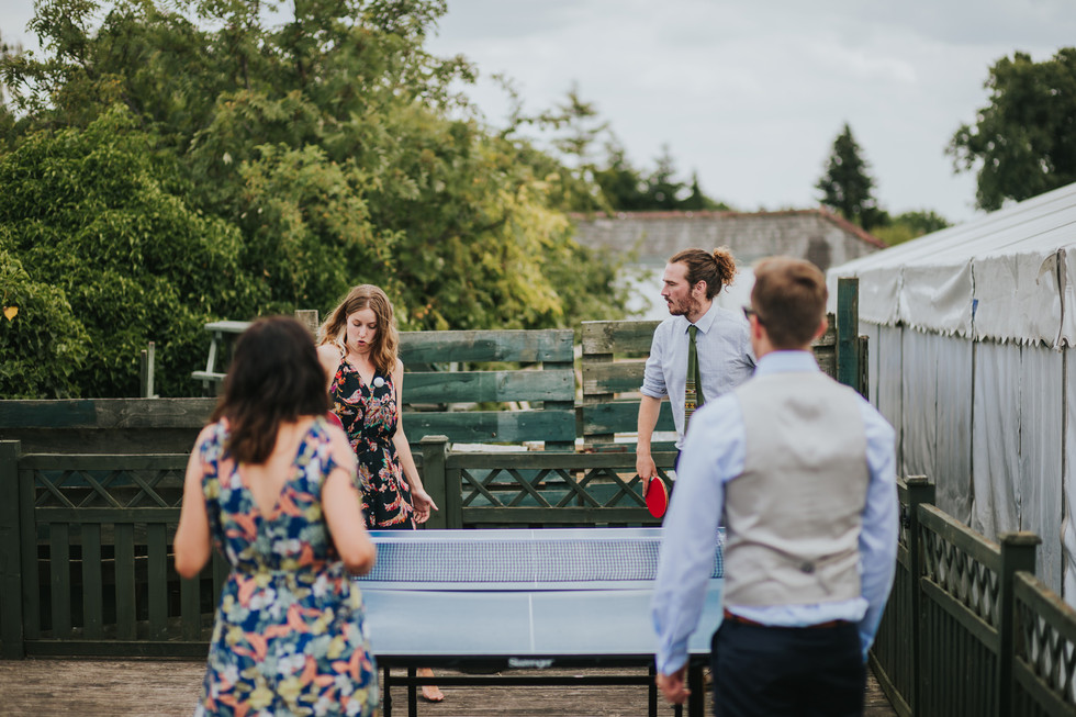 guests playing ping pong on the decking at the old white beare