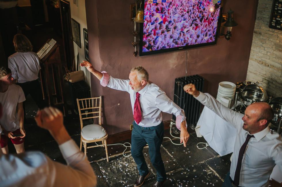 guests dancing and cheering watching england play football