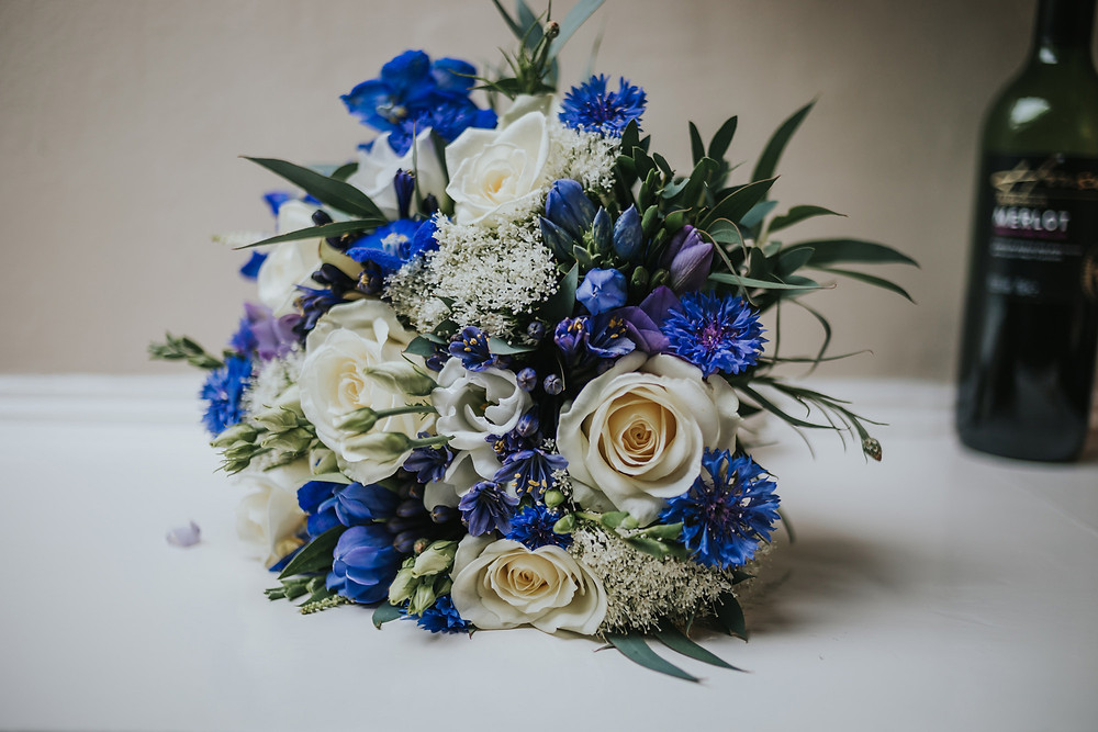 Brides blue and white bouquet on a table
