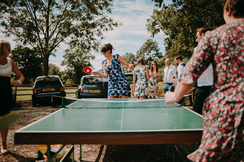 Guests playing ping pong at Bolton Abbey Village Hall