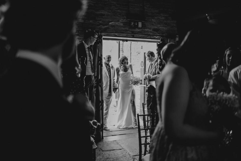 Bride walking through the door for the pub wedding