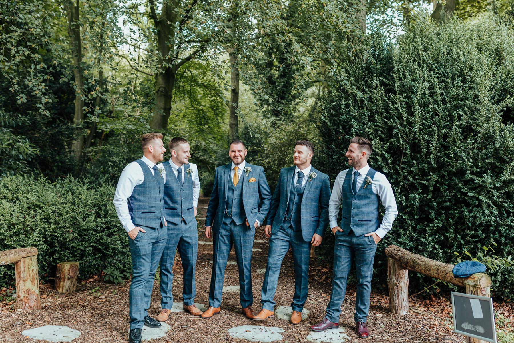 groomsmen in the woods at hazlewood castle