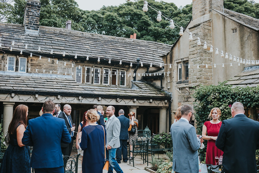 guests chatting in the courtyard at holdsworth house