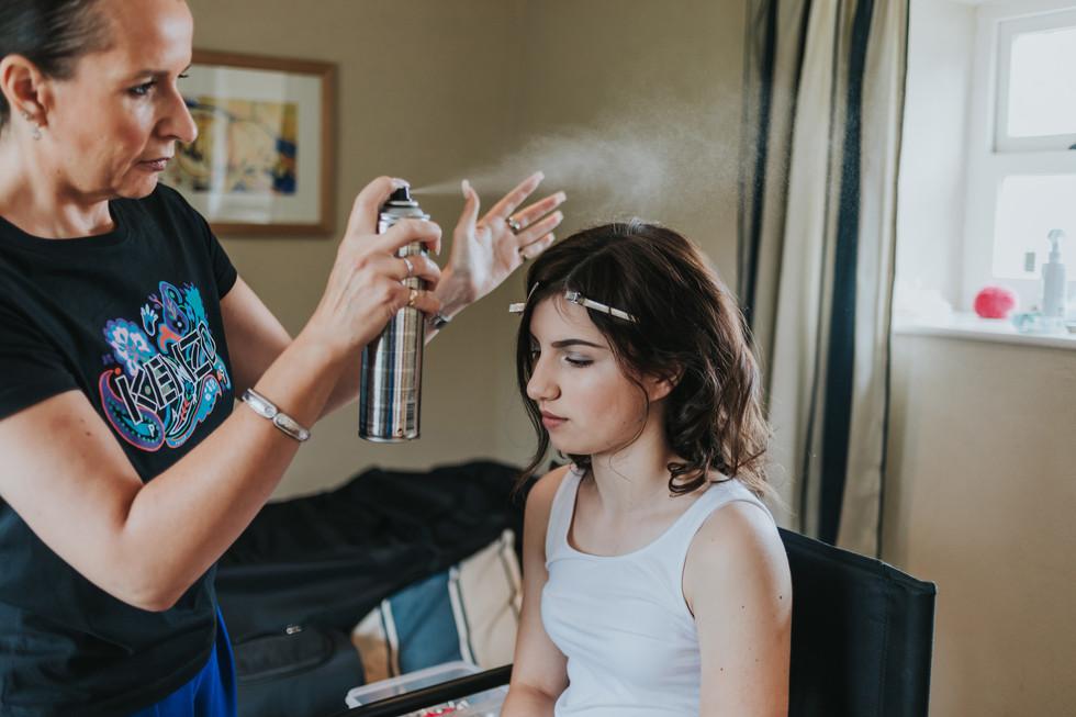wedding hairdresser doing a bridesmaids hair
