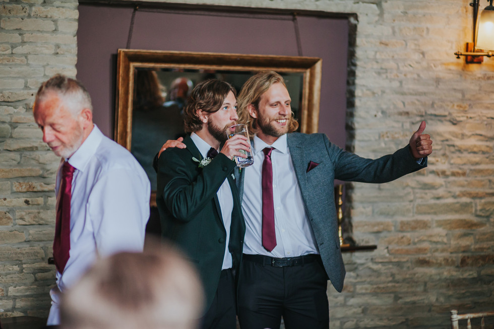 Groom and best man having a drink before the wedding