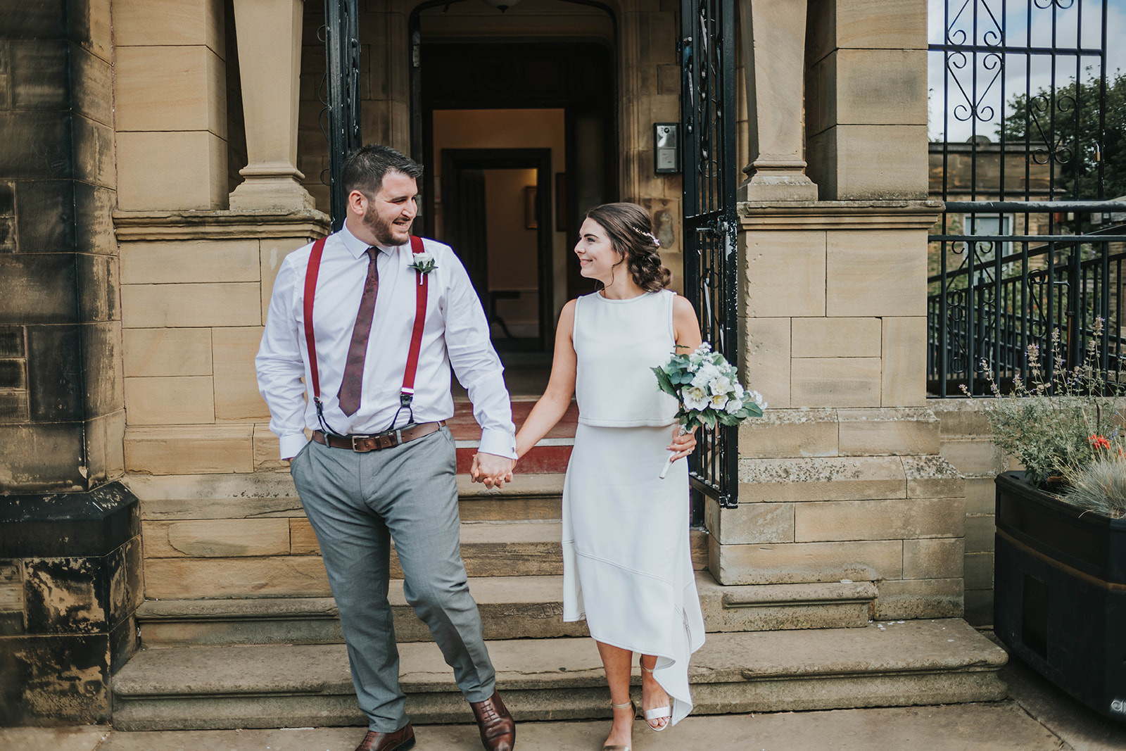 bride and groom leaving calderdale registry office in halifax after the ceremony
