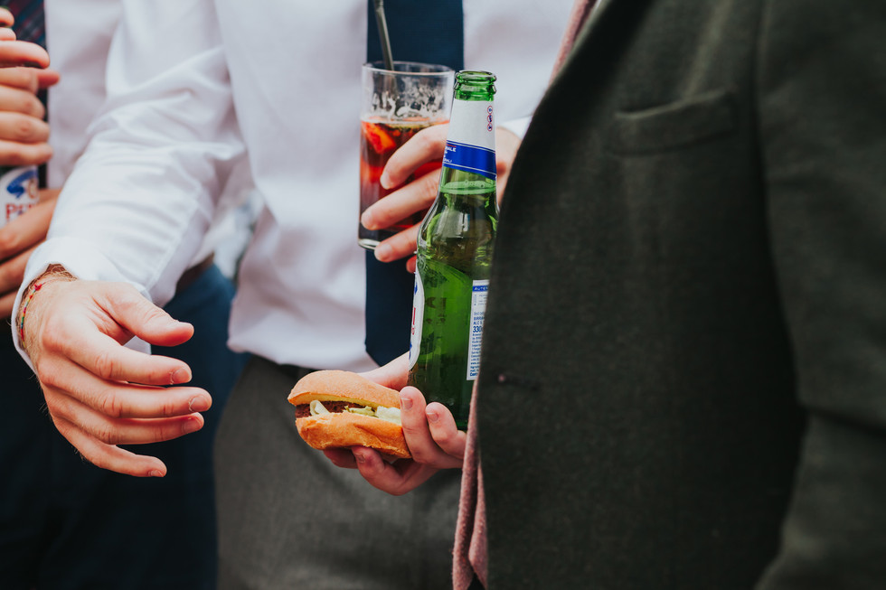 guests eating burgers and drinking beer