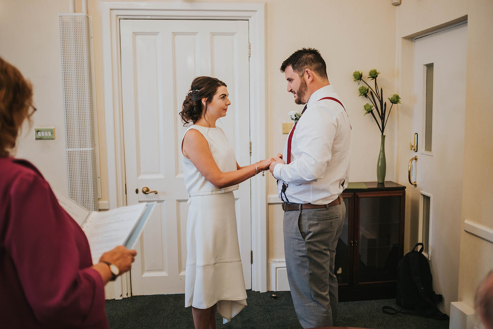 bride and groom saying their vows at calderdale register office