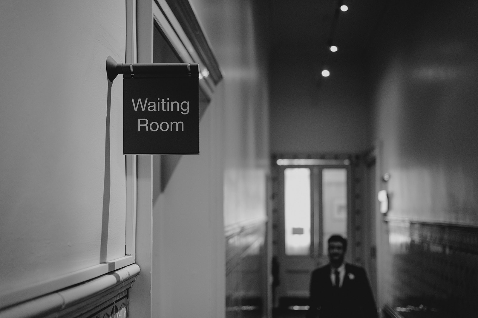 Waiting room sign inside Leeds Town Hall