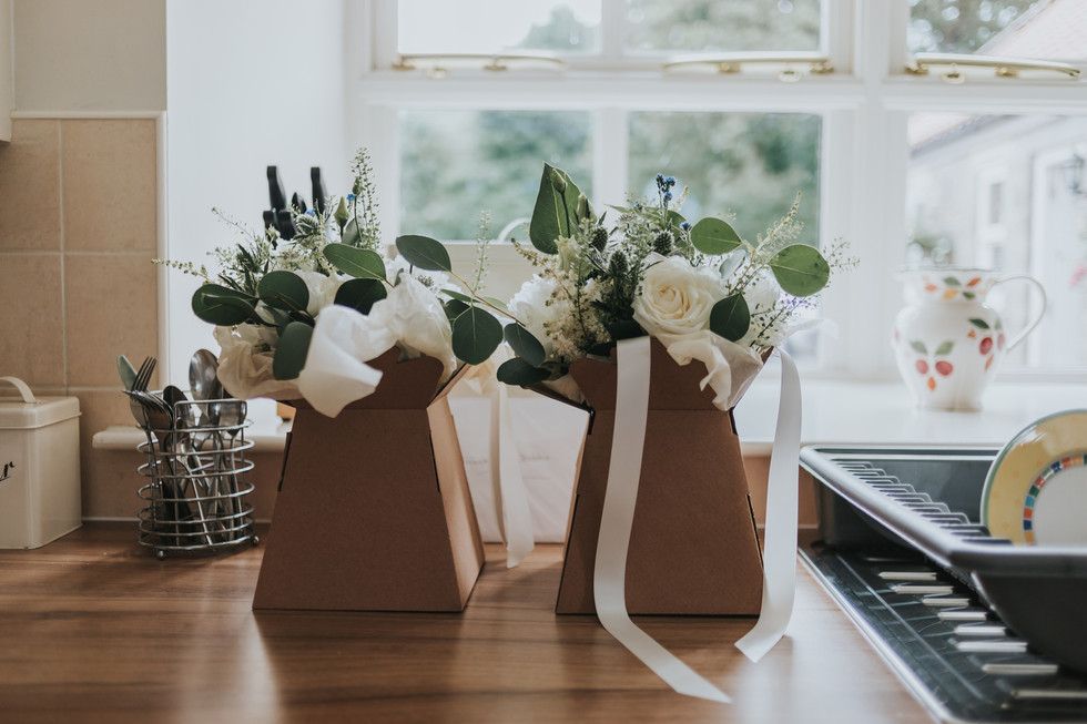 bridesmaid wedding bouquets on a windowsill