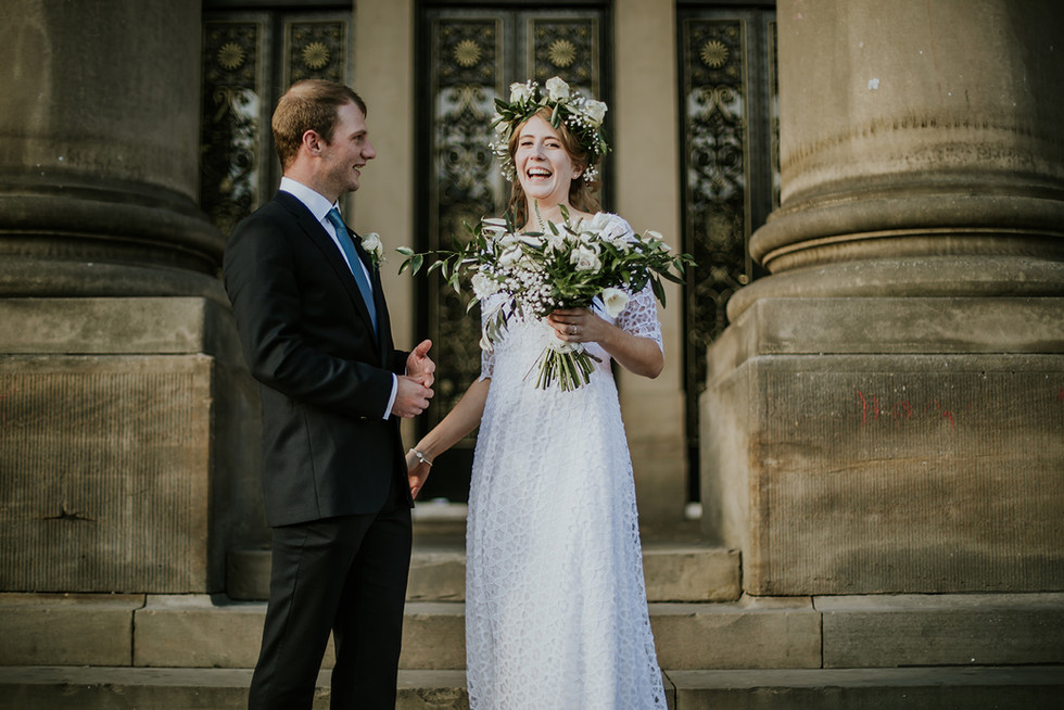 bride and groom laughing on the steps