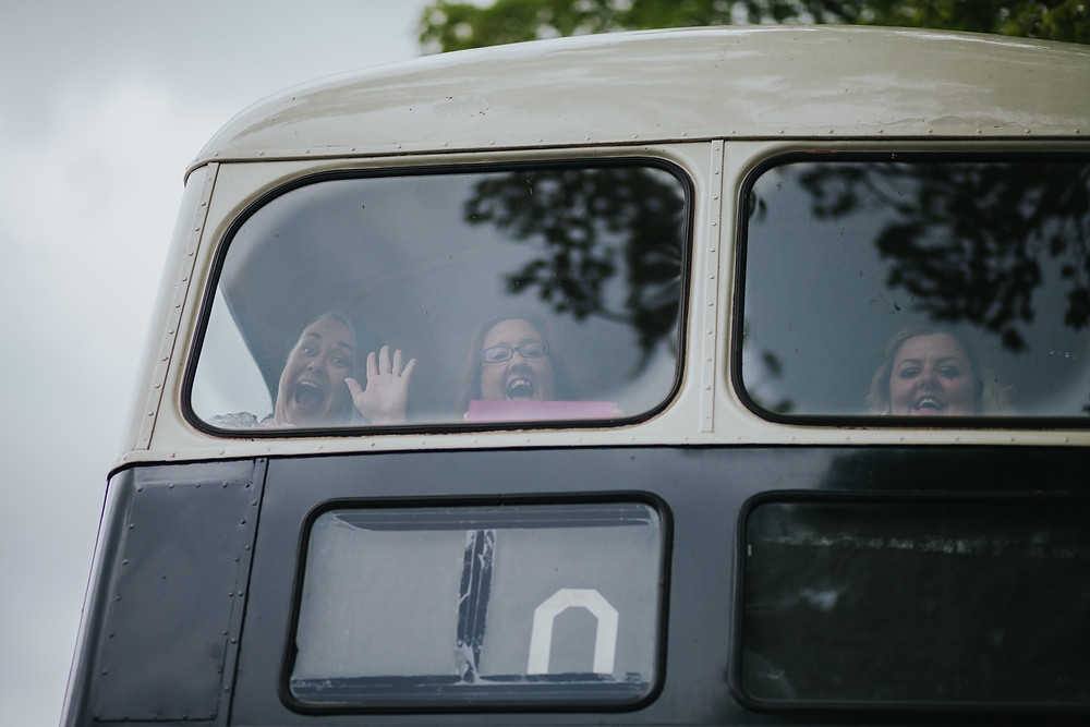 guests on vintage wedding bus in west yorkshire wedding photography