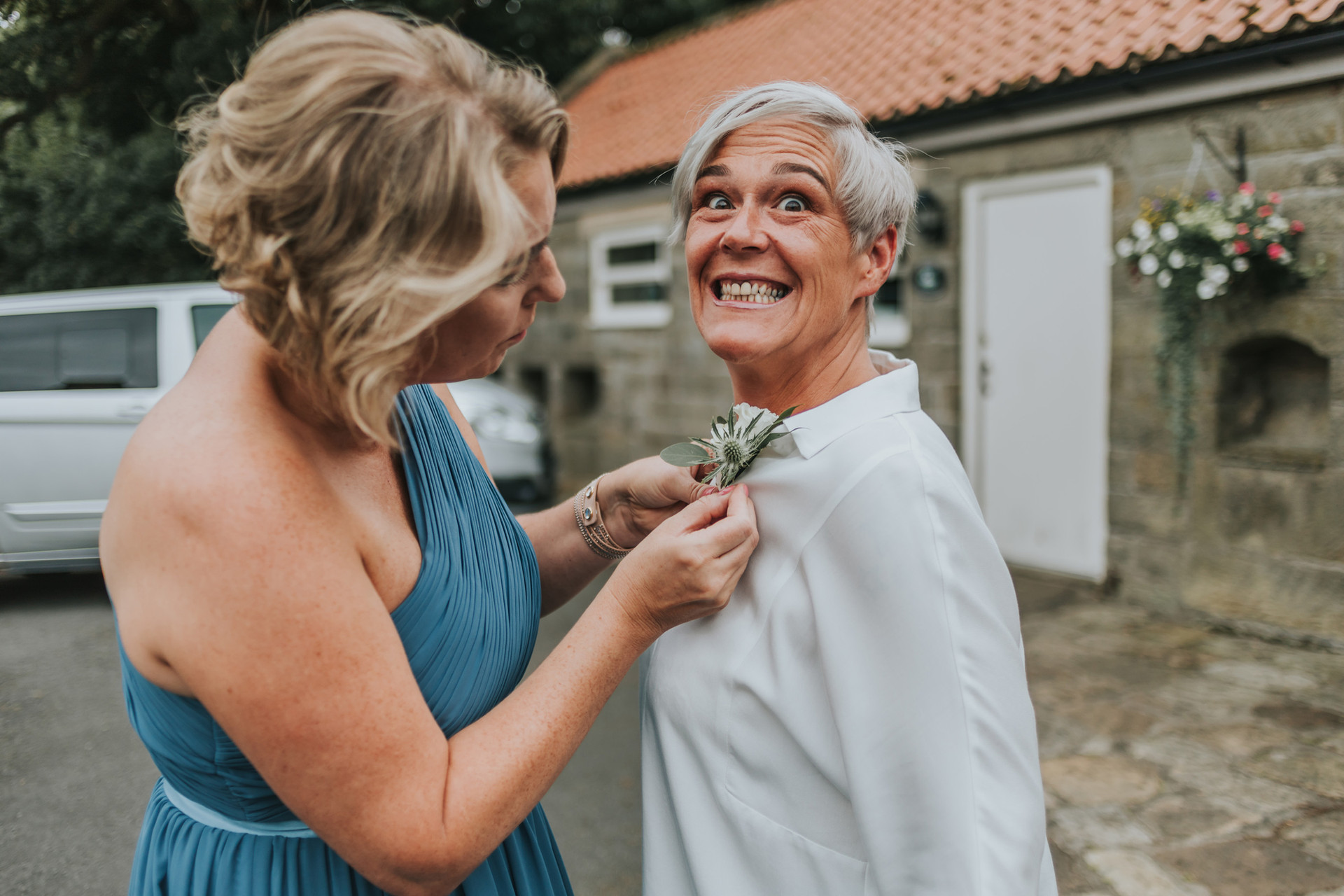 Best woman putting on her wedding corsage