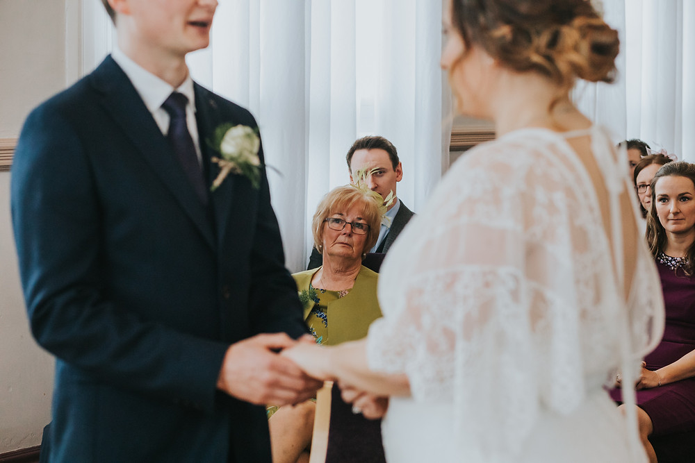 mum watching as the couple get married