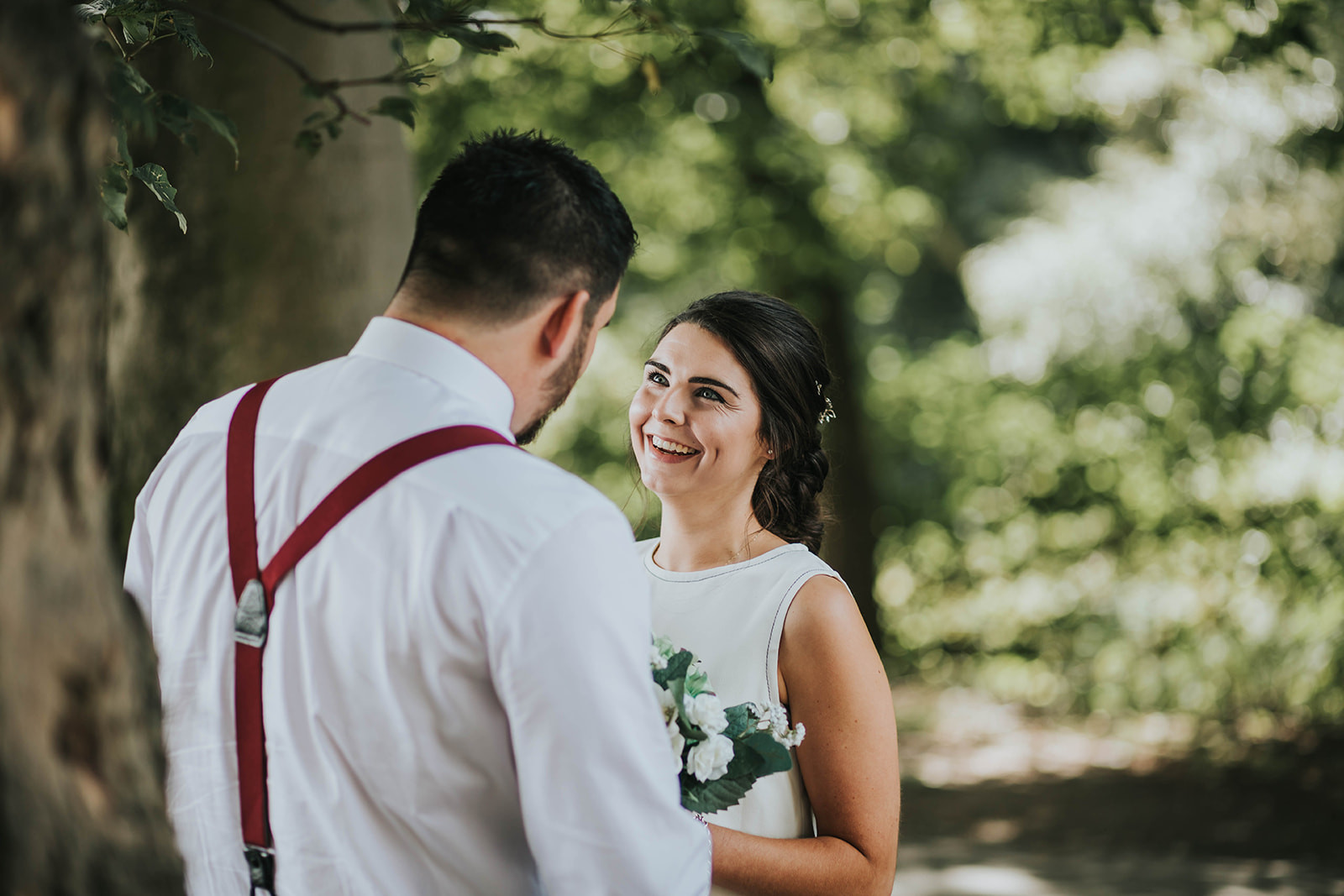 bride and groom laughing together at the maypole inn, warley