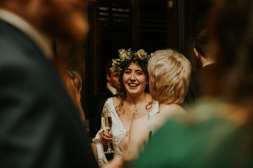 bride smiling at her friends