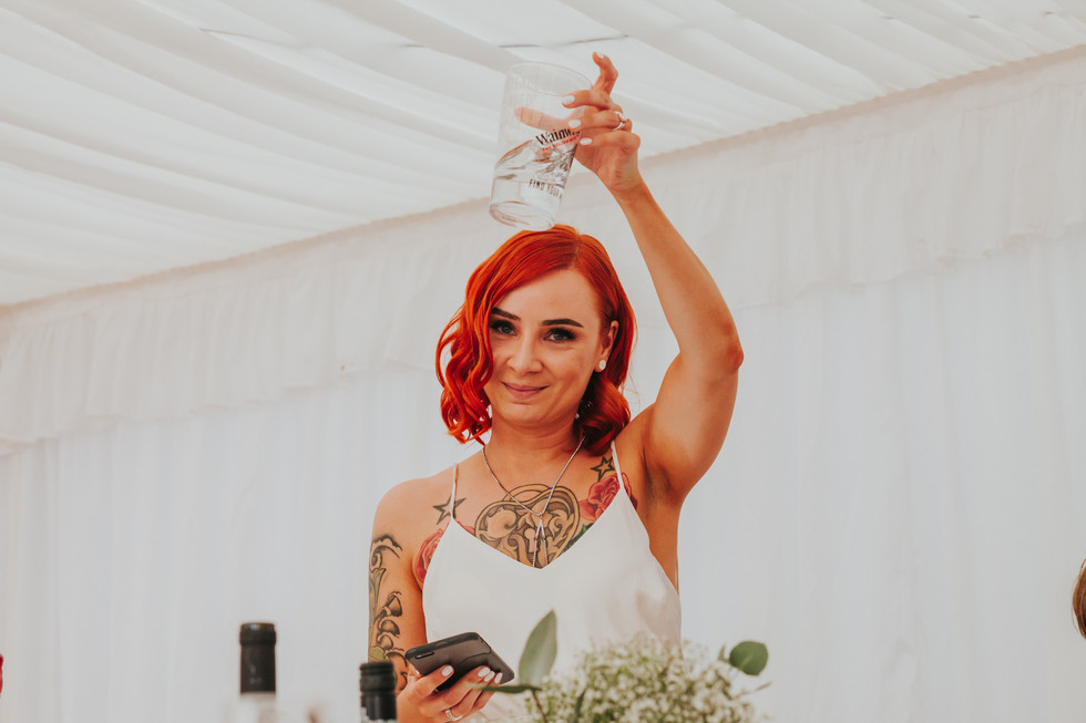 red haired bride giving a speech