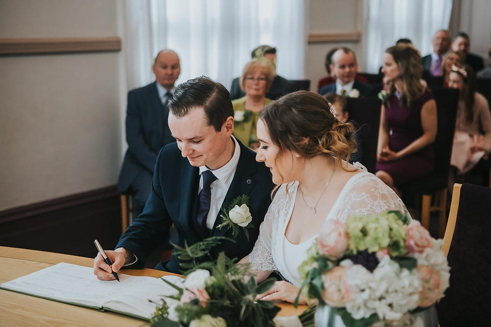 signing the register, leeds town hall wedding