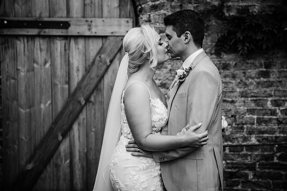 Wedding couple in the walled garden at the fig house middleton lodge