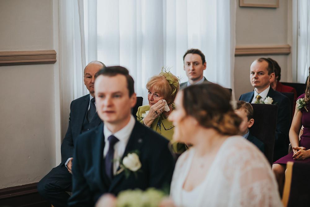 mum crying at wedding ceremony