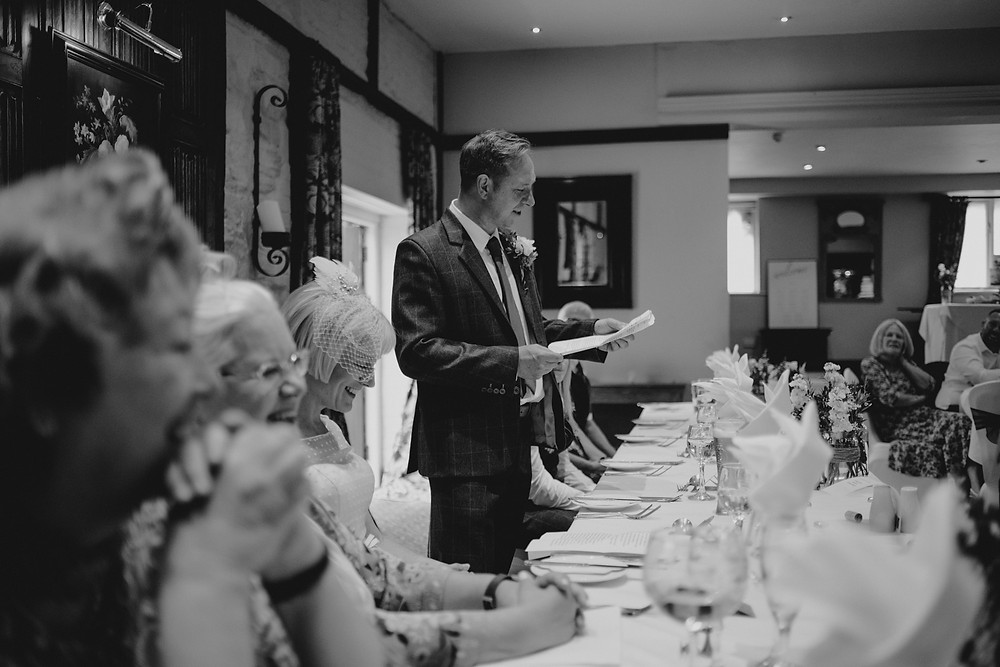 groom giving a speech before food at holdsworth house