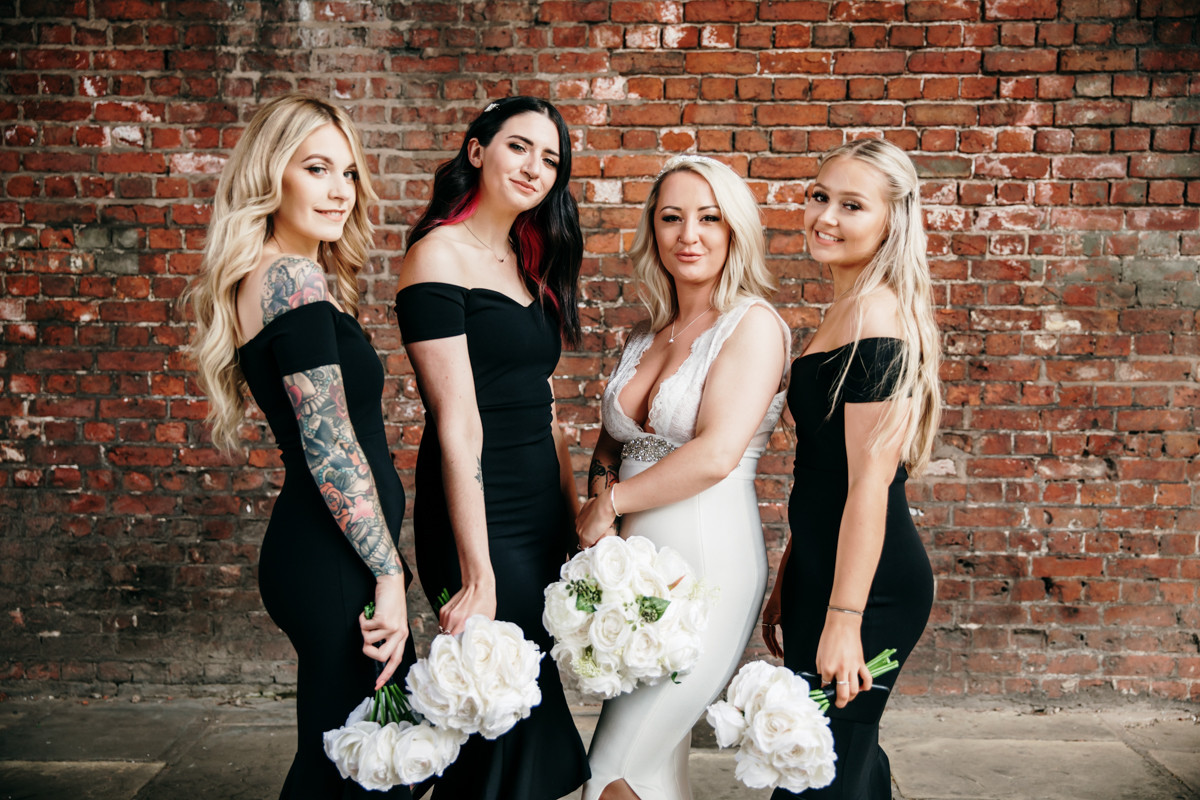 bride and bridesmaids under the arches in manchester