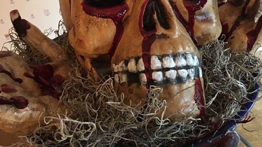 Skull and hands in bucket