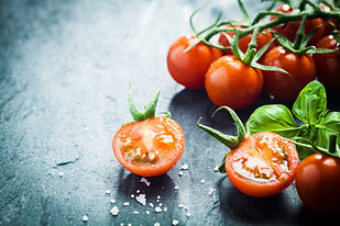 Fresh grape tomatoes with basil and coar