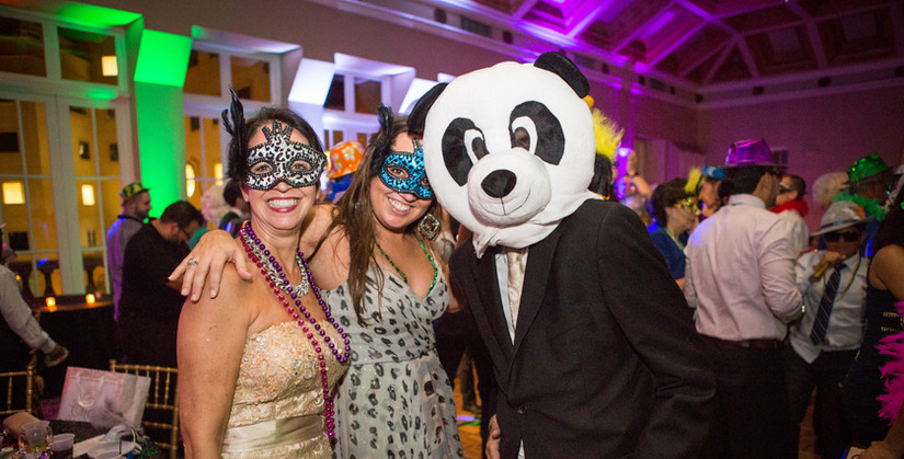 Two ladies and a panda bear head