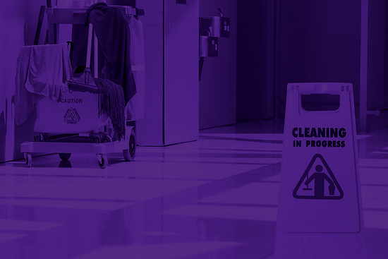 janitor cart with mop and wet floor sign