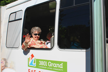 Dorothy enjoys a ride in our minibus on a lovely day!