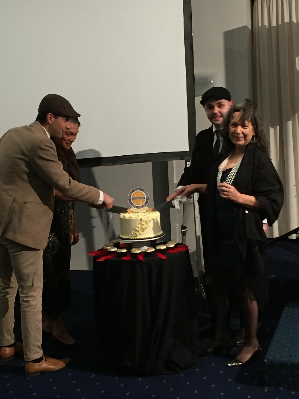 Vivenne cutting the cake
