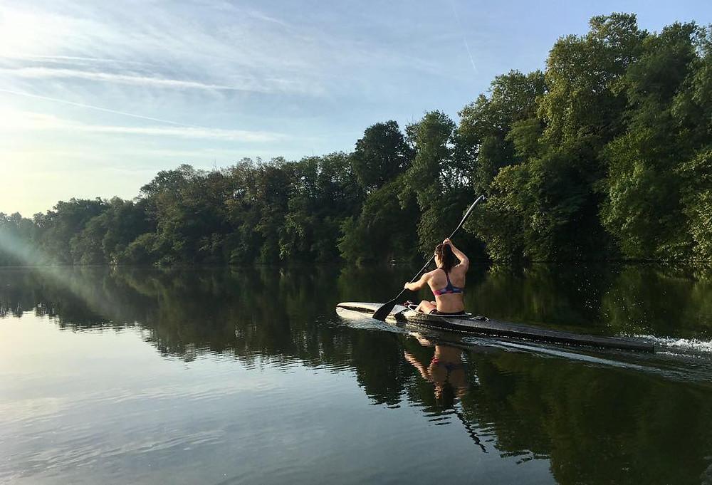 Kayla paddling on river