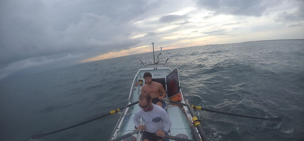 Grant and Charlie rowing from Singapore to Australia