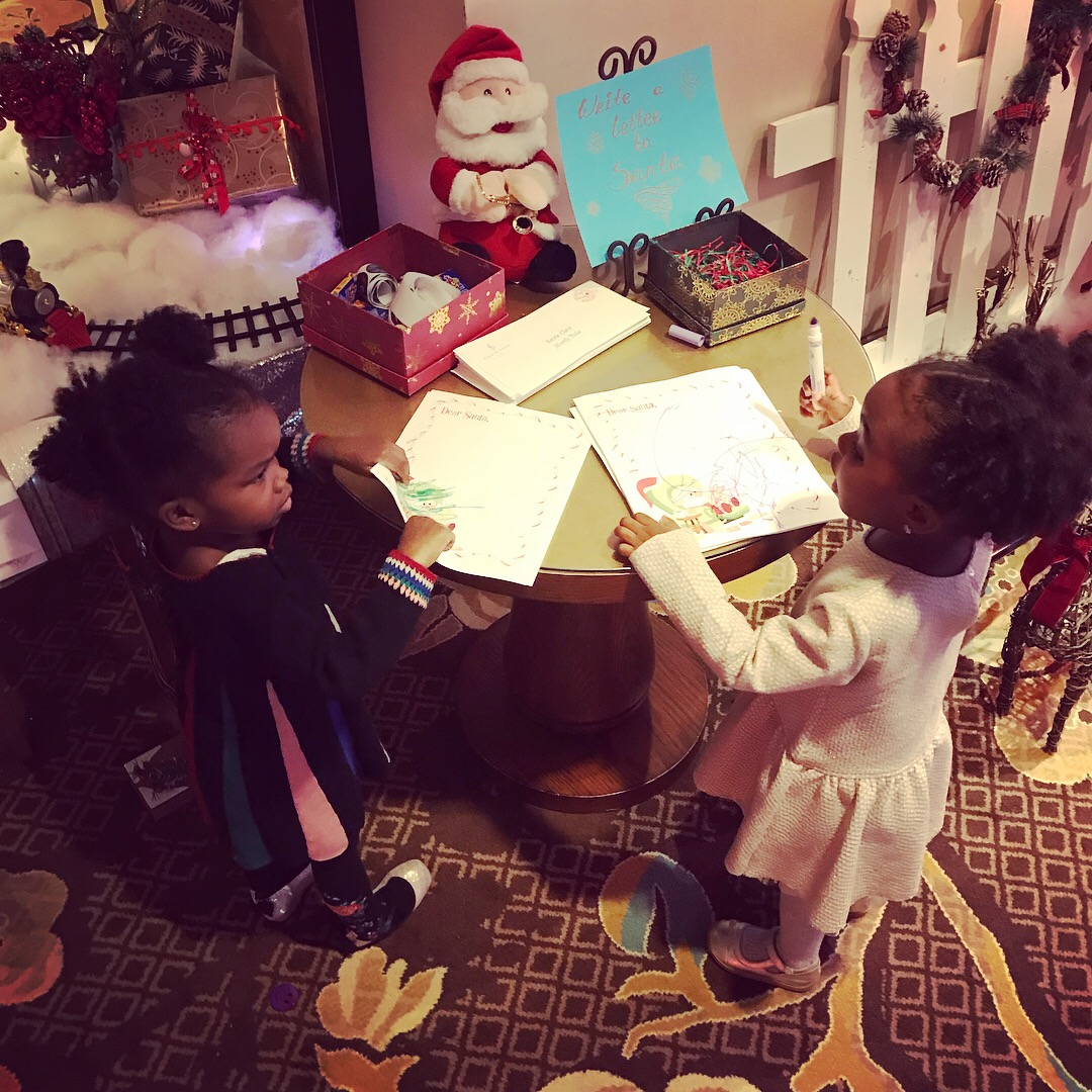 Discussing their Letters to Santa at The Four Seasons