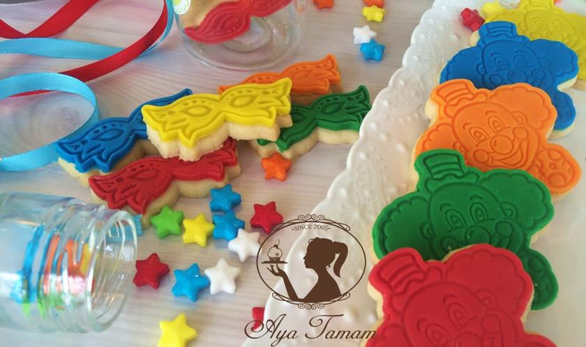 פורים עוגיות מעוצבות ליצנים ומסכות.jpg