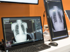 What is teleradiology, and how does a 21st-century clinic or hospital benefit from this?