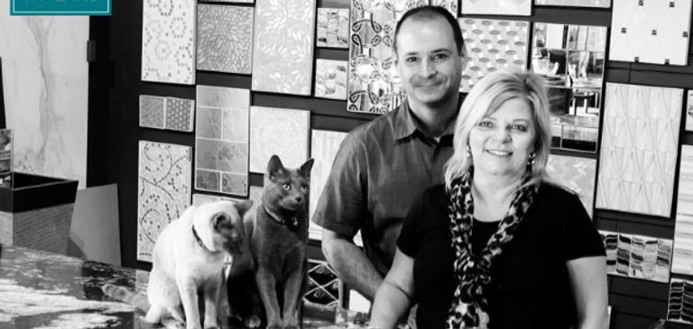 Melissa Turpin and Paul Mudd pose with the workplace cats Luka and Carrara