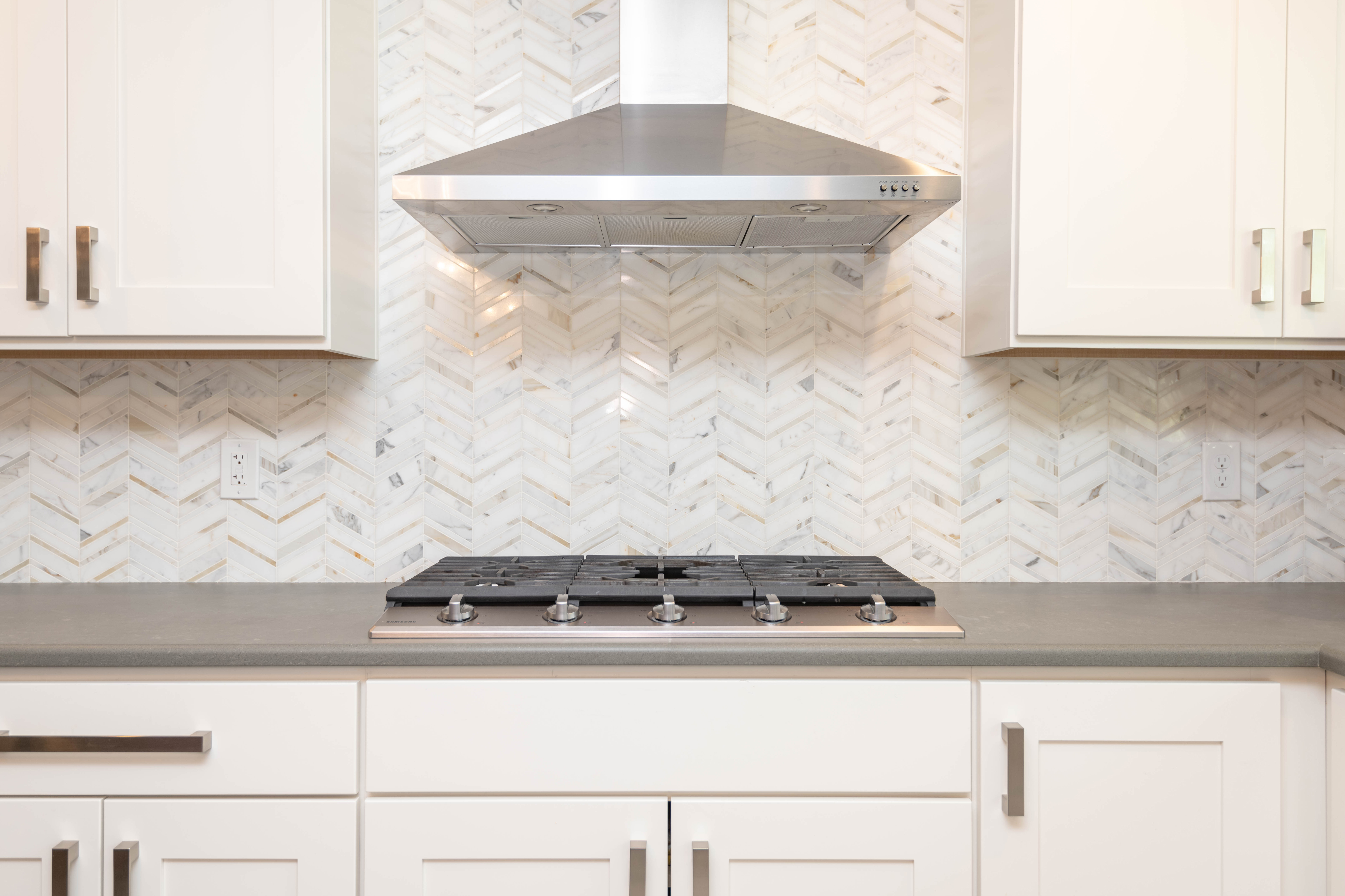 white-herringbone-backsplash