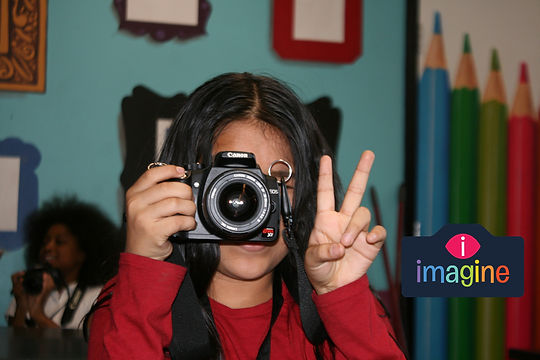 girl with camera and logo 2.jpg