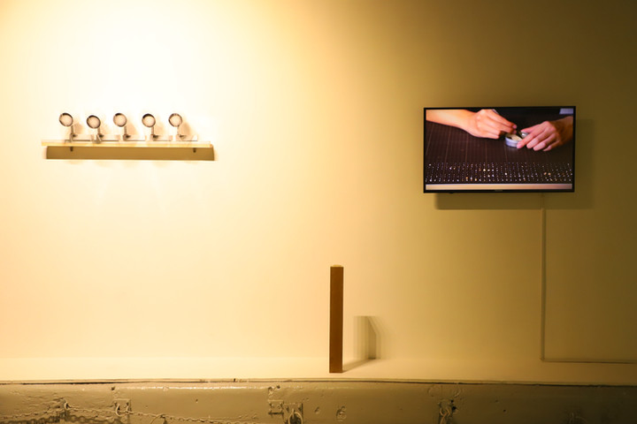 """Respond to """"Listen Up?!"""" gallery light shaped paper sacrifices. a pinch of sand. a pinch of sand in a row, in order."""