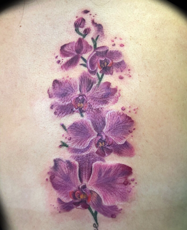 watercolor orchid floral tattoo