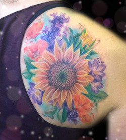 sunflower watercolor tattoo