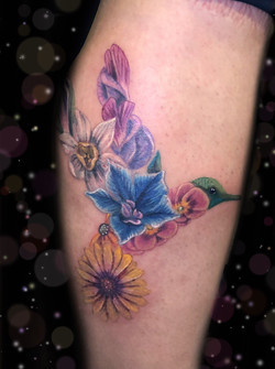 floral hummingbird tattoo