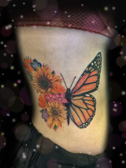 hald flower half butterfly tattoo