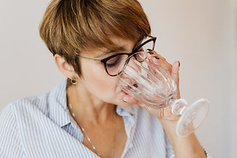 woman-with-short-hair-in-glasses-drinkin