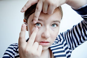 girl putting contact lenses in.jpg