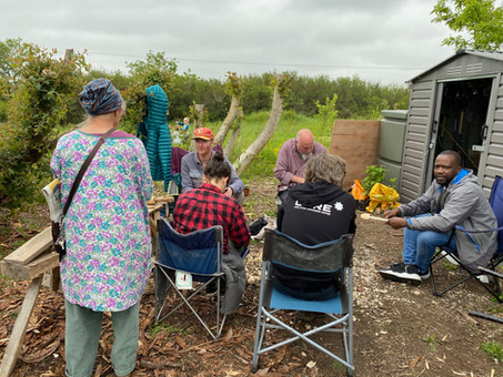 John, spoon carving with a group of visitors at Cilgerran Fruit and Nuts club open day - Spoon whittling