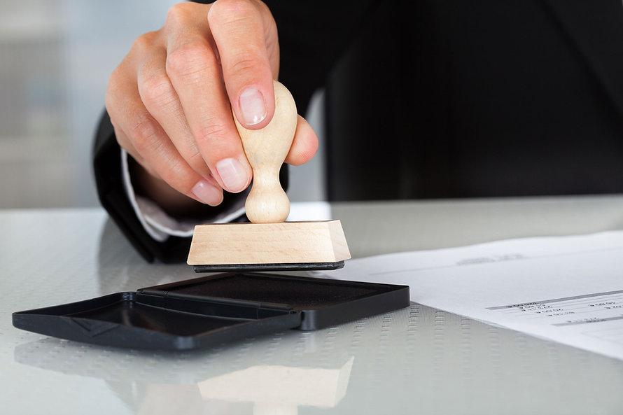Man using notary stamp