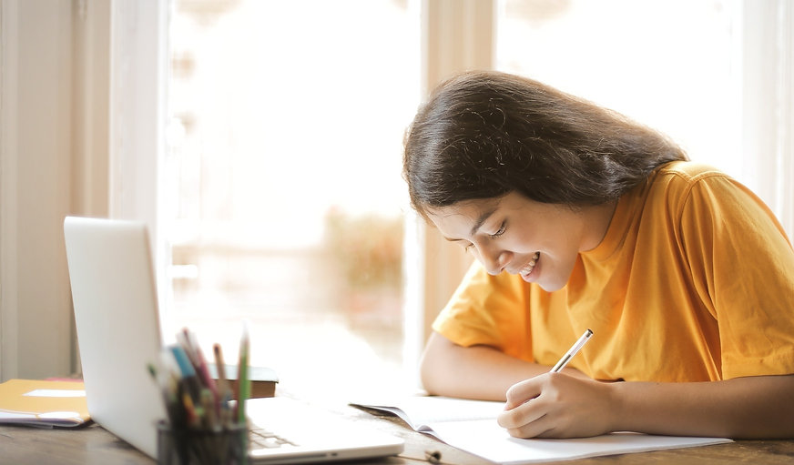 woman-in-yellow-shirt-writing-on-white-p
